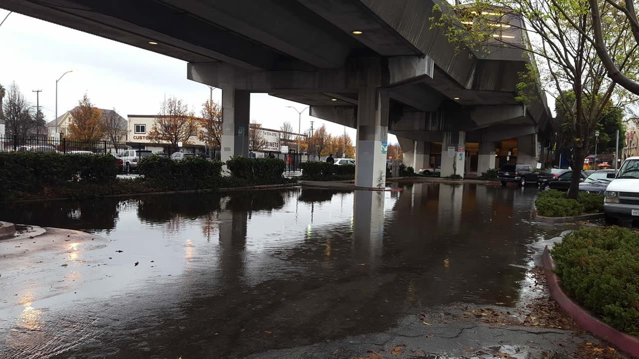 This photo shows flooding at a parking lot next to the Fruitvale BART station in Oakland, Calif. on Wednesday, January 6, 2016.KGO-TV