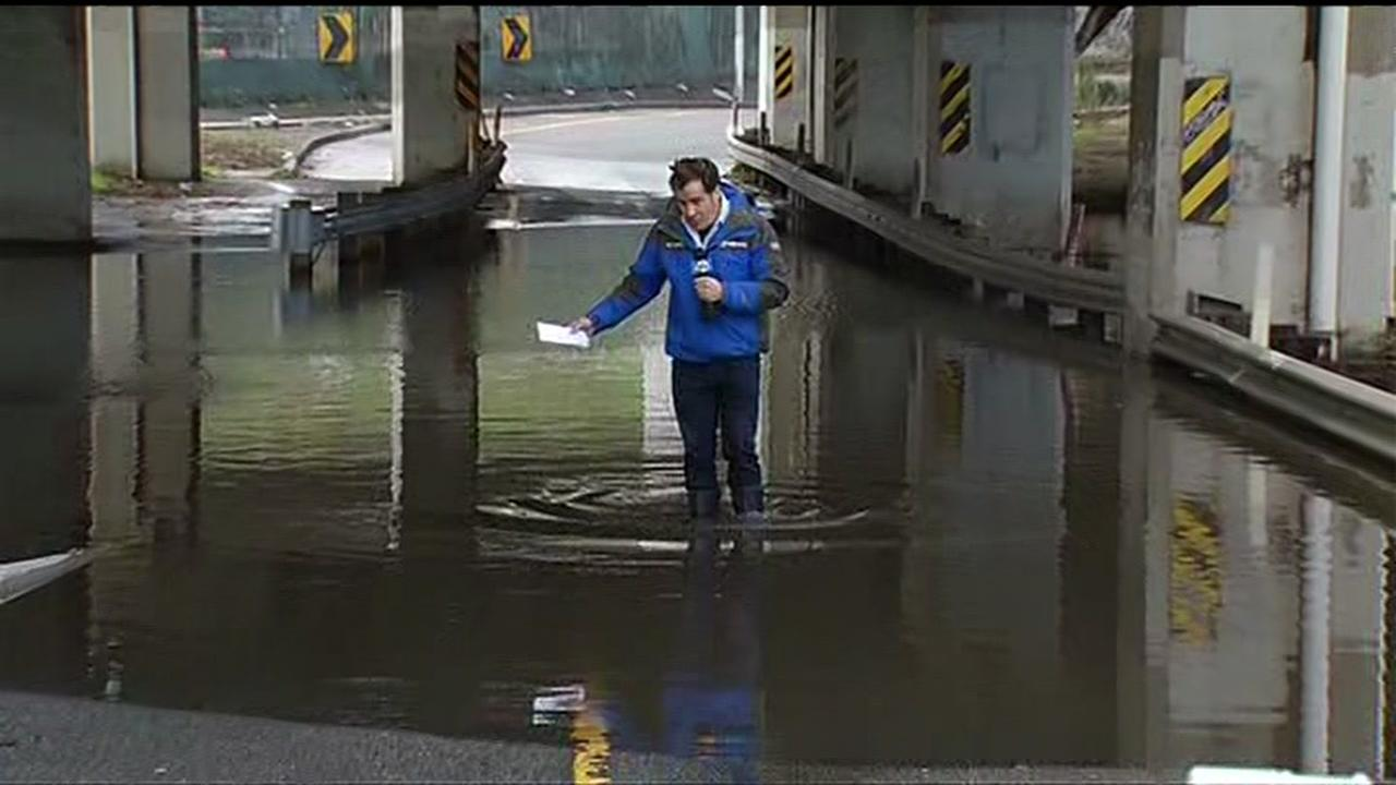 Cornell Barnard reported for ABC7 News while standing on a flooded Alemany Boulevard in San Francisco on Wednesday, January 6, 2016.KGO-TV