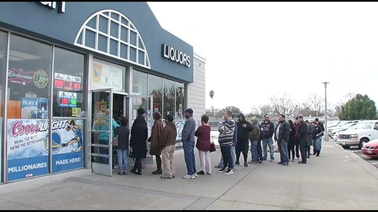 The line for Powerball tickets stretched out the doors at Kavanagh Liquors #1 in San Lorenzo, Calif. on Friday, January 8, 2016.