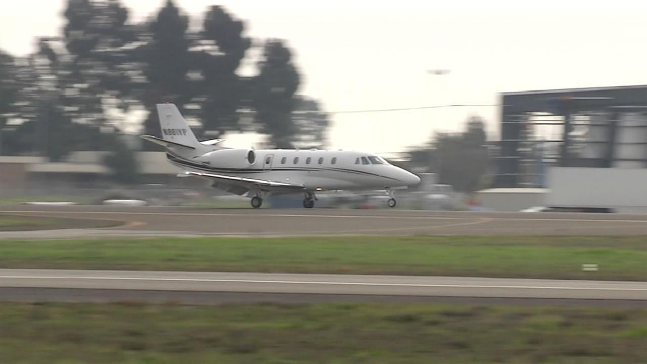 This undated image shows a private jet landing at a Bay Area airport.