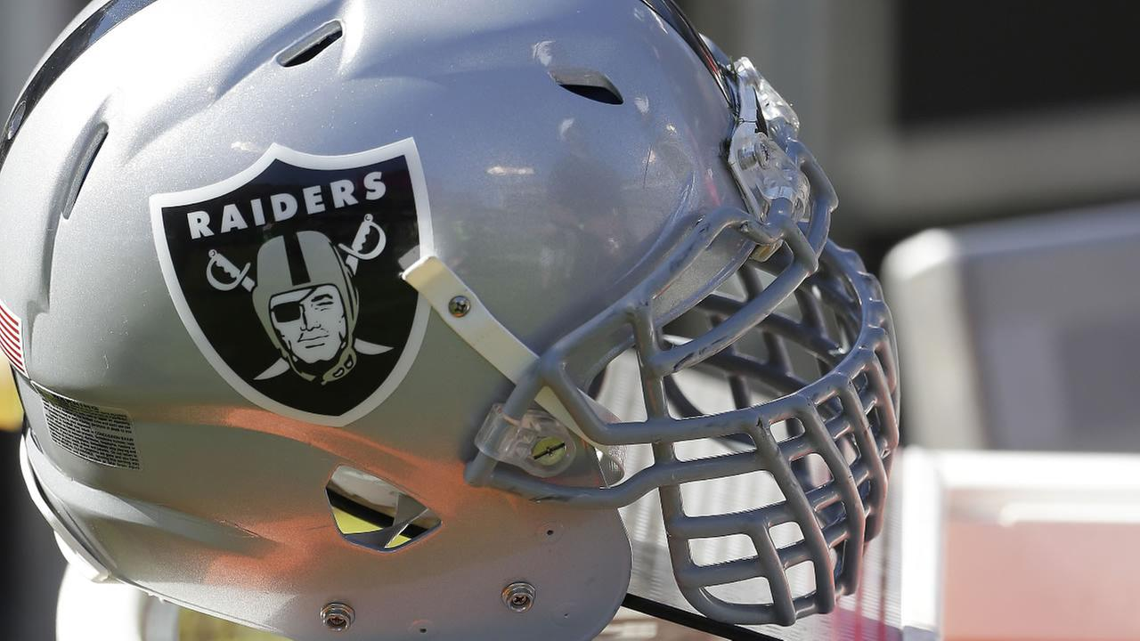 The helmet of Oakland Raiders Justin Tuck is shown during the second half of an NFL football game against the Denver Broncos in Oakland, Calif. on Oct. 11, 2015. (AP Photo)