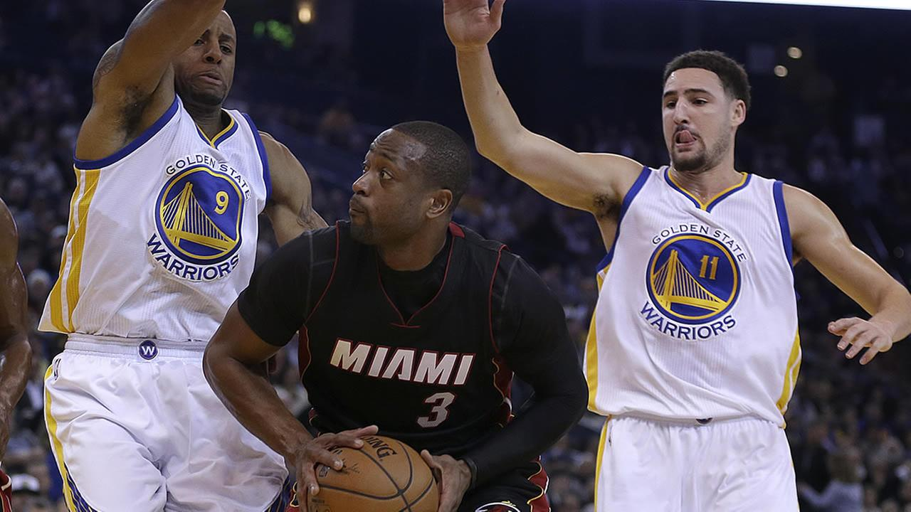 Miami Heat guard Dwyane Wade and Golden State Warriors Andre Iguodala and Klay Thompson