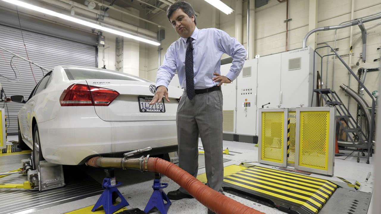 FILE - In this Sept. 30, 2015, file photo, John Swanton, spokesman with the California Air Resources Board, explains how a 2013 Volkswagen Passat is evaluated at the emissions test lab in El Monte, Calif.