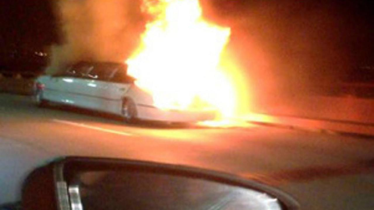 This frame grab taken from video provided by Roxana and Carlos Guzman shows a Limo on fire Saturday, May 4, 2013, on the San Mateo-Hayward Bridge in San Francisco. (AP Photo)