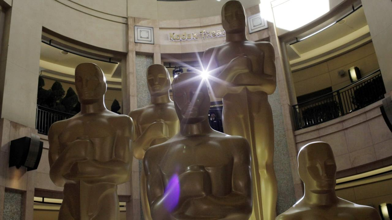 Oscar statues stand in front of the Kodak Theatre as preparations for the 83rd Academy Awards continue in Los Angeles, Saturday, Feb. 26, 2011. (AP Photo/Jae C. Hong)