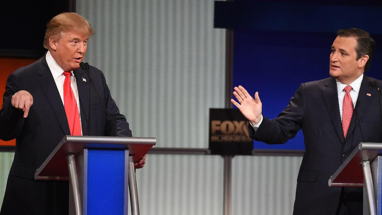 Republican presidential candidate, Donald Trump, left, speaks as Republican presidential candidate, Sen. Ted Cruz, R-Texas, speaks at the GOP presidential debate in South Carolina.