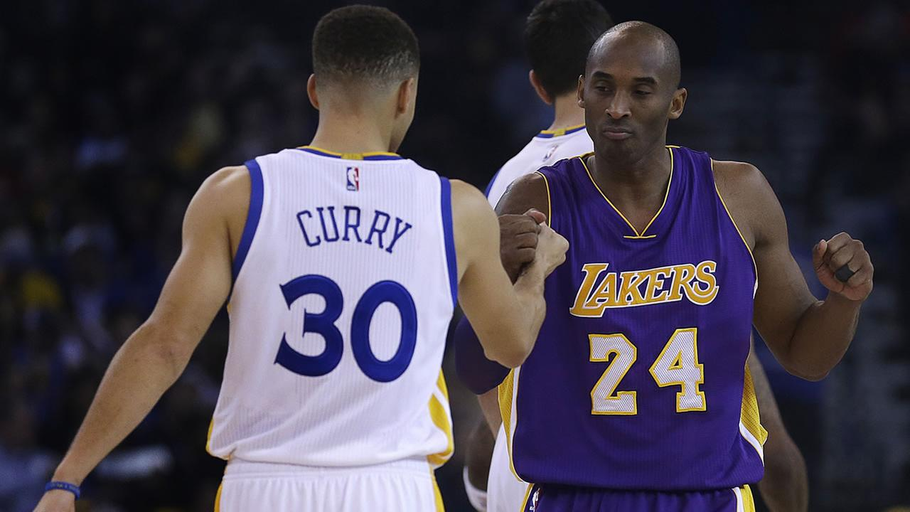 Los Angeles Lakers Kobe Bryant, right, greets Golden State Warriors Stephen Curry (30) prior to an NBA basketball game Thursday, Jan. 14, 2016, in Oakland, Calif. (AP Photo/Ben Margot)