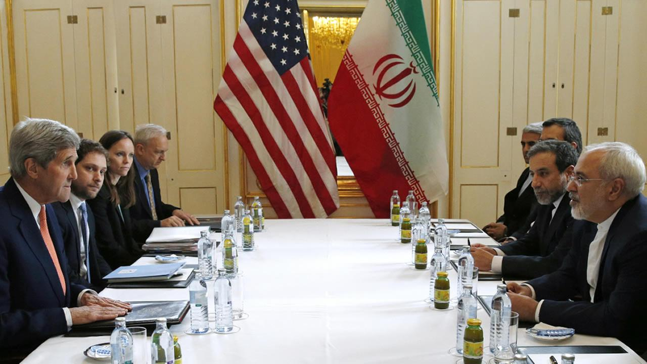 U.S. Secretary of State John Kerry, left, meets with Iranian Foreign Minister Mohammad Javad Zarif, right, in Vienna, Austria, Saturday, Jan. 16, 2016.