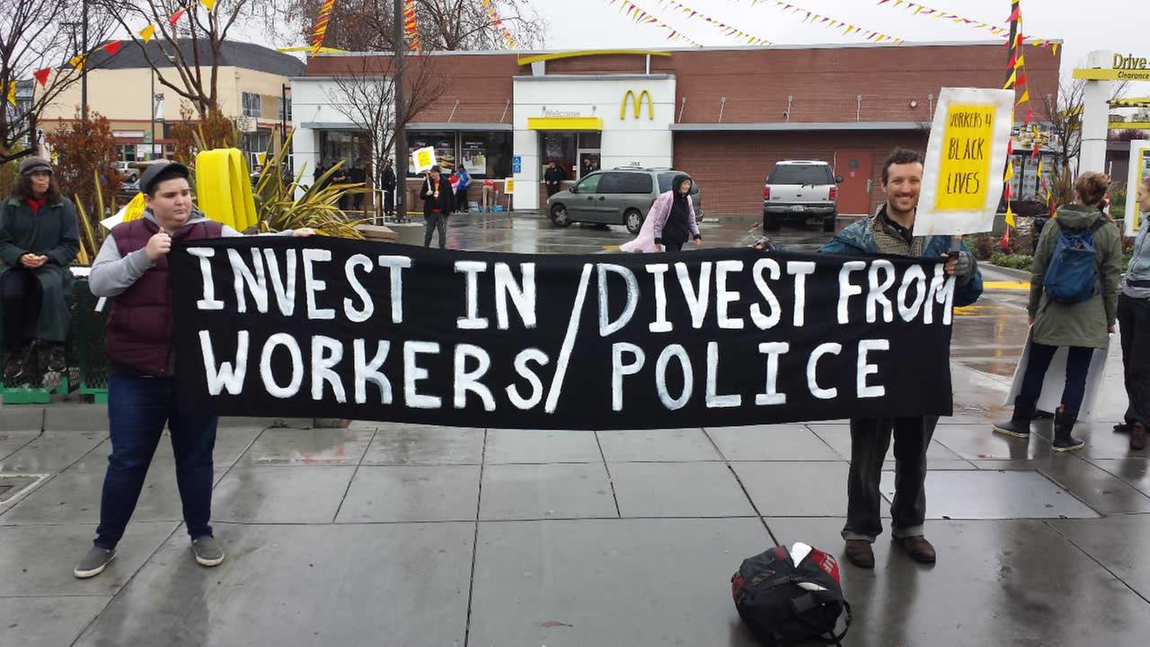 Activists demonstrate outside a McDonalds in Oakland, Calif., on Saturday, January 16, 2016.