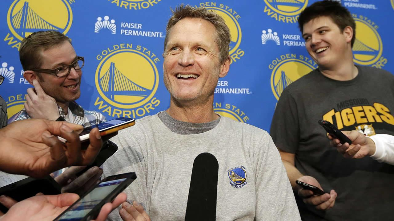 Golden State Warriors head coach Steve Kerr smiles while speaking to reporters at the teams practice facility in Oakland, Calif., Thursday, June 18, 2015. (AP Photo/Jeff Chiu)