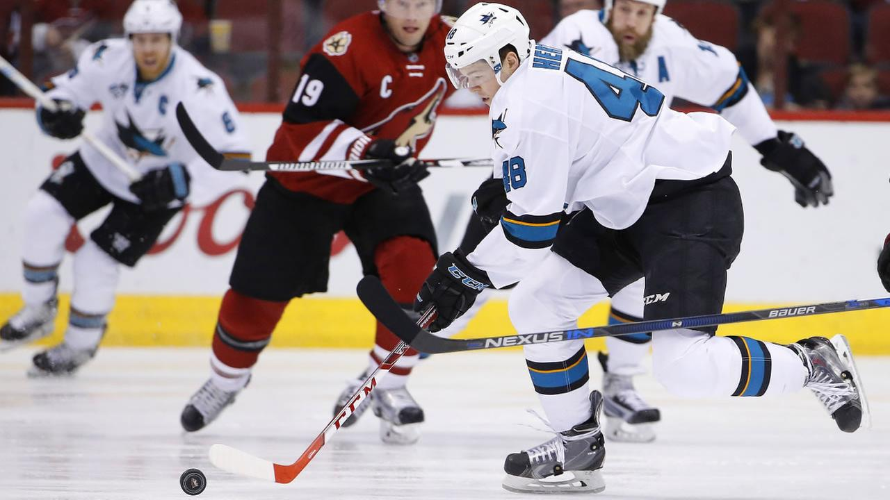 San Jose Sharks Tomas Hertl (48), of the Czech Republic, skates with the puck in front of Arizona Coyotes Shane Doan (19) during an NHL hockey game, Thursday, Jan. 21, 2015.