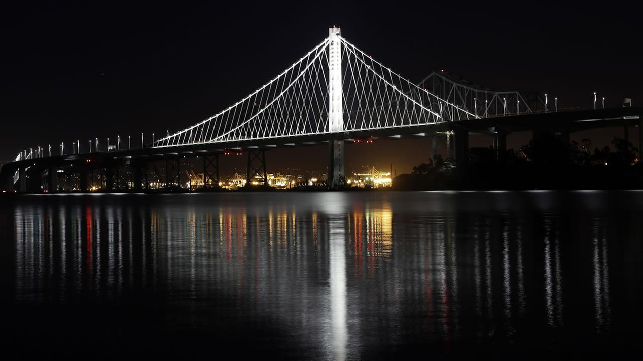 FILE - This Dec. 26, 2013 file photo shows the new eastern span of the San Francisco-Oakland Bay Bridge reflected on the water in a view from Treasure Island in San Francisco.