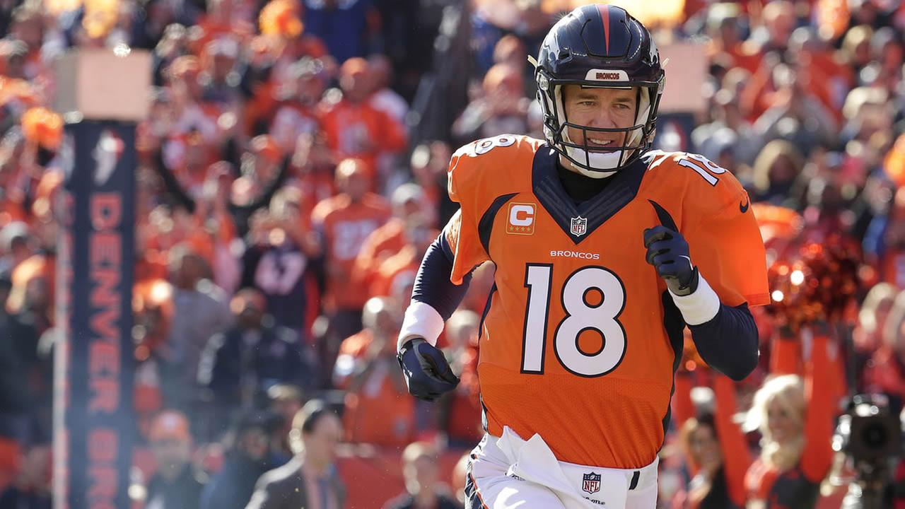 Broncos Peyton Manning runs onto the field for the first half the NFL football AFC Championship game between the Broncos and Patriots, Sunday, Jan. 24, 2016, in Denver. (AP Photo)