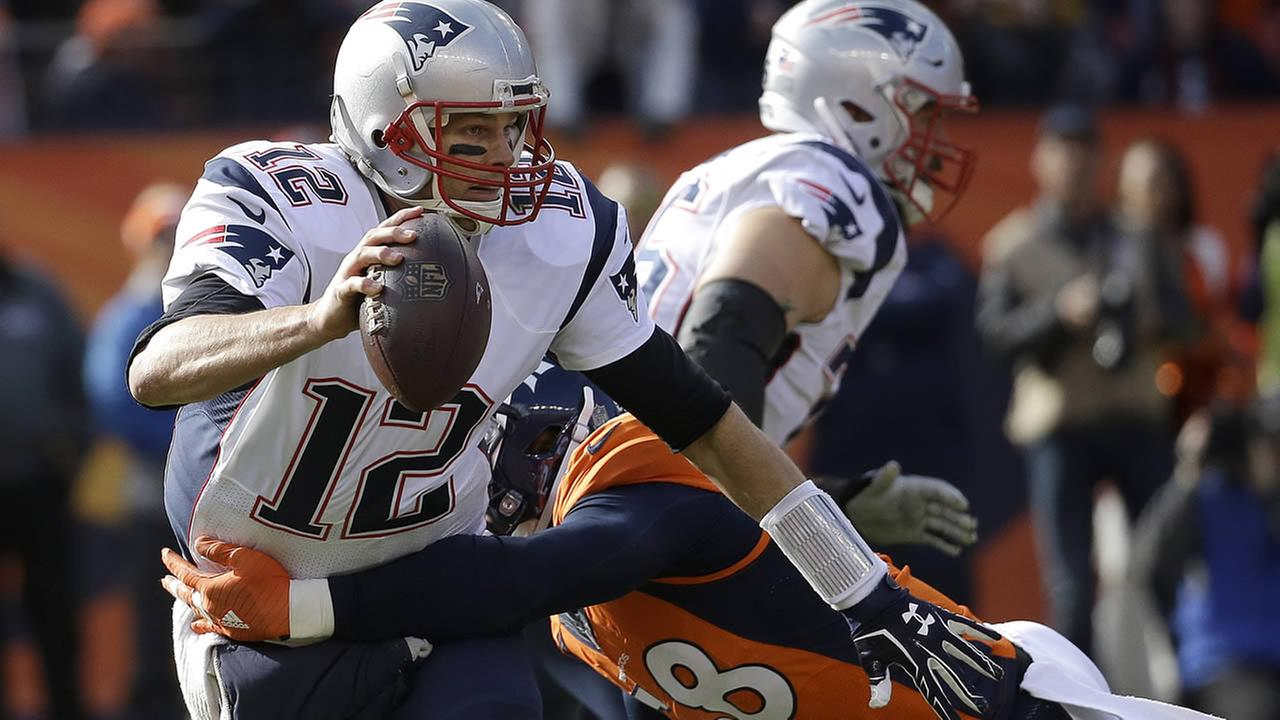 Patriots Tom Brady is tackled by Broncos Von Miller during the NFL football AFC Championship game between the Broncos and Patriots, Sunday, Jan. 24, 2016, in Denver. (AP Photo)