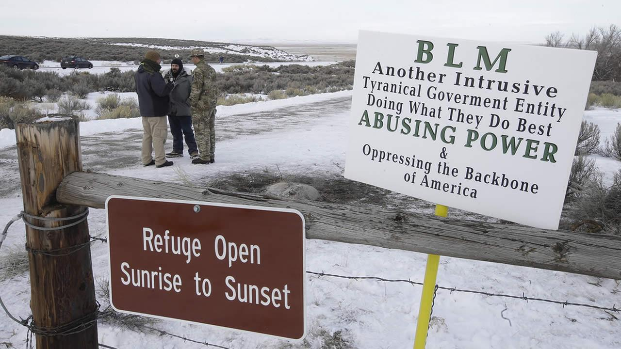 Members of the group occupying the Malheur National Wildlife Refuge headquarters stand guard Monday, Jan. 4, 2016, near Burns, Ore.