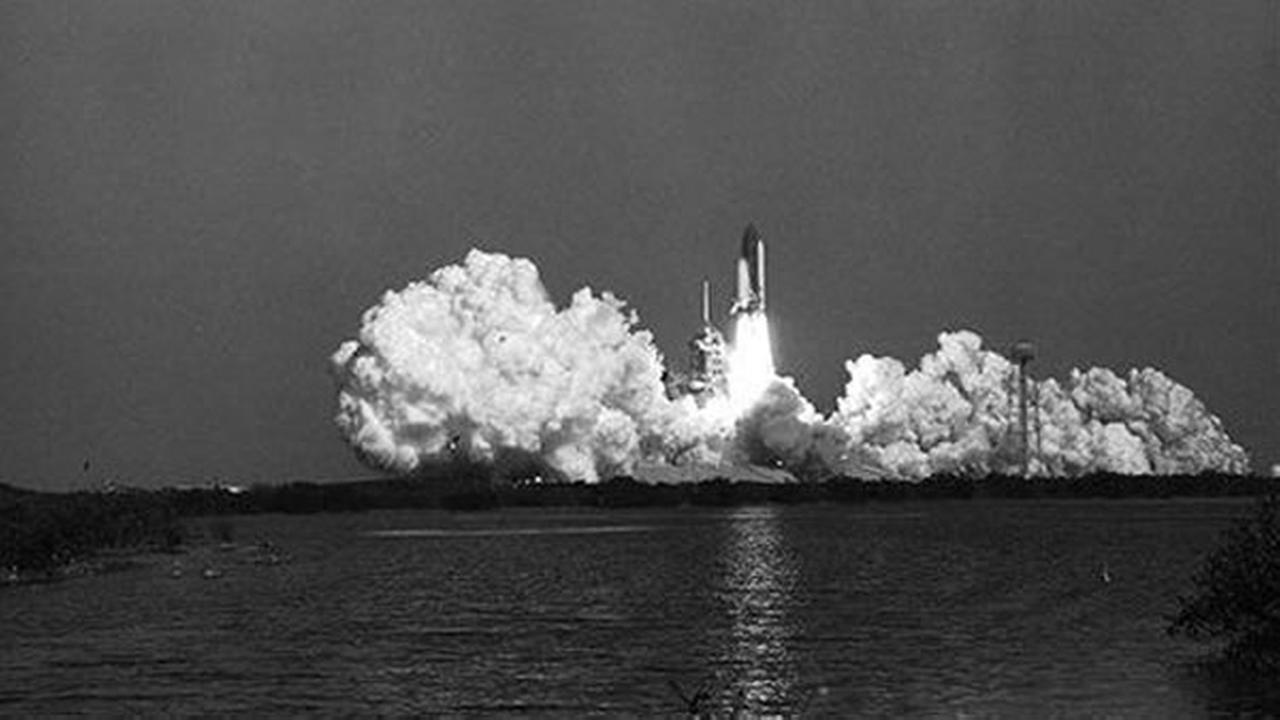 After creating a huge cloud of smoke, the Space Shuttle Challenger lifts off from Kennedy Space Center.