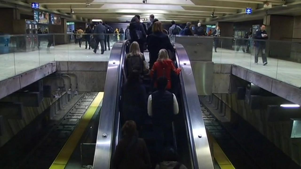 Commuters are seen on an escalator at the Embarcadero BART station in San Francisco on Friday, January 29, 2016.