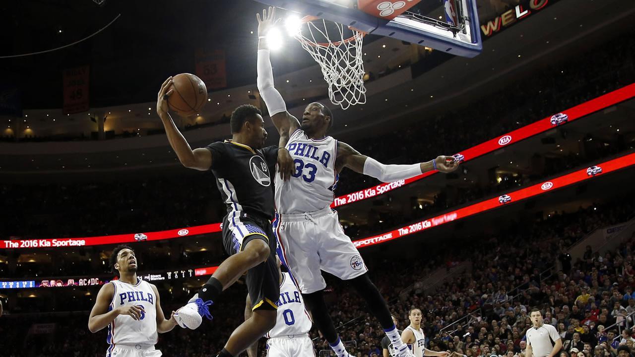 Golden State Warriors Leandro Barbosa (19) tries to pass the ball against Philadelphia 76ers Robert Covington (33) during an NBA basketball game, Jan. 30 in Philadelphia.