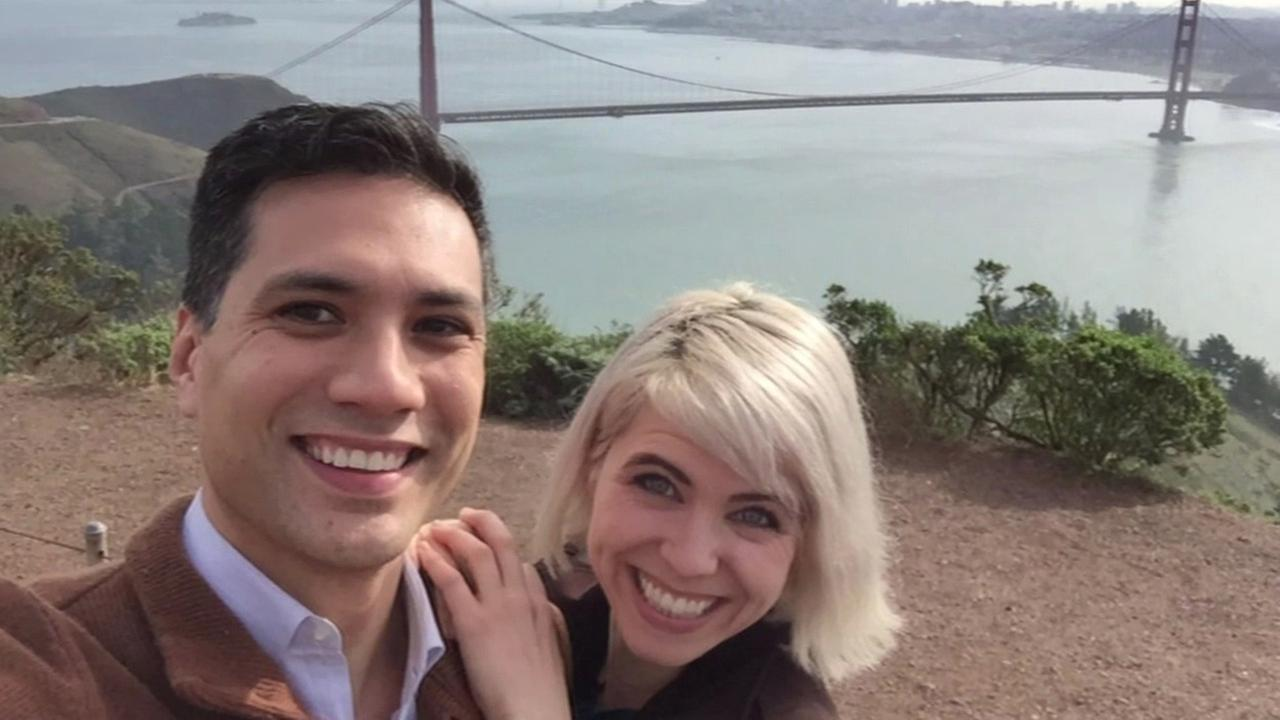 ABC7 News anchor Reggie Aqui and Samantha Gilweit of Dylans Tour take a selfie with the Golden Gate Bridge in background.