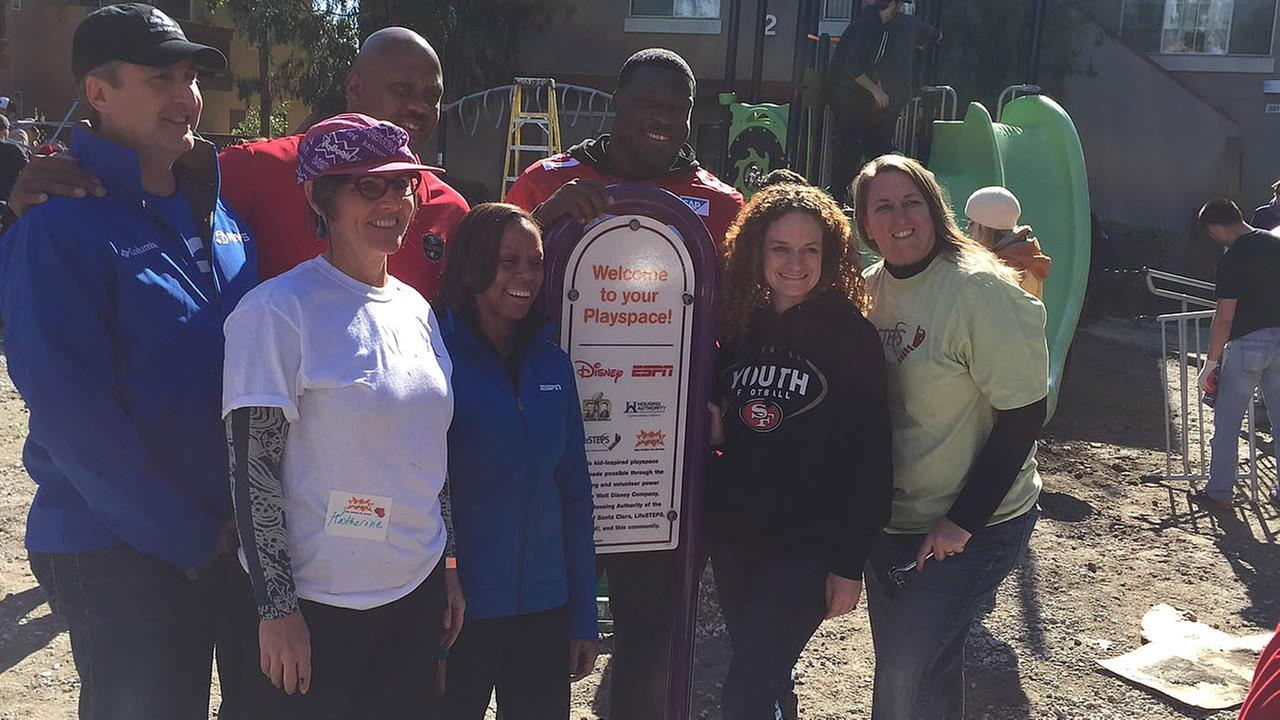 Volunteers pose for a photo at the KaBoom playground build in San Jose, Calif. on Tuesday, February 2, 2016.KGO-TV