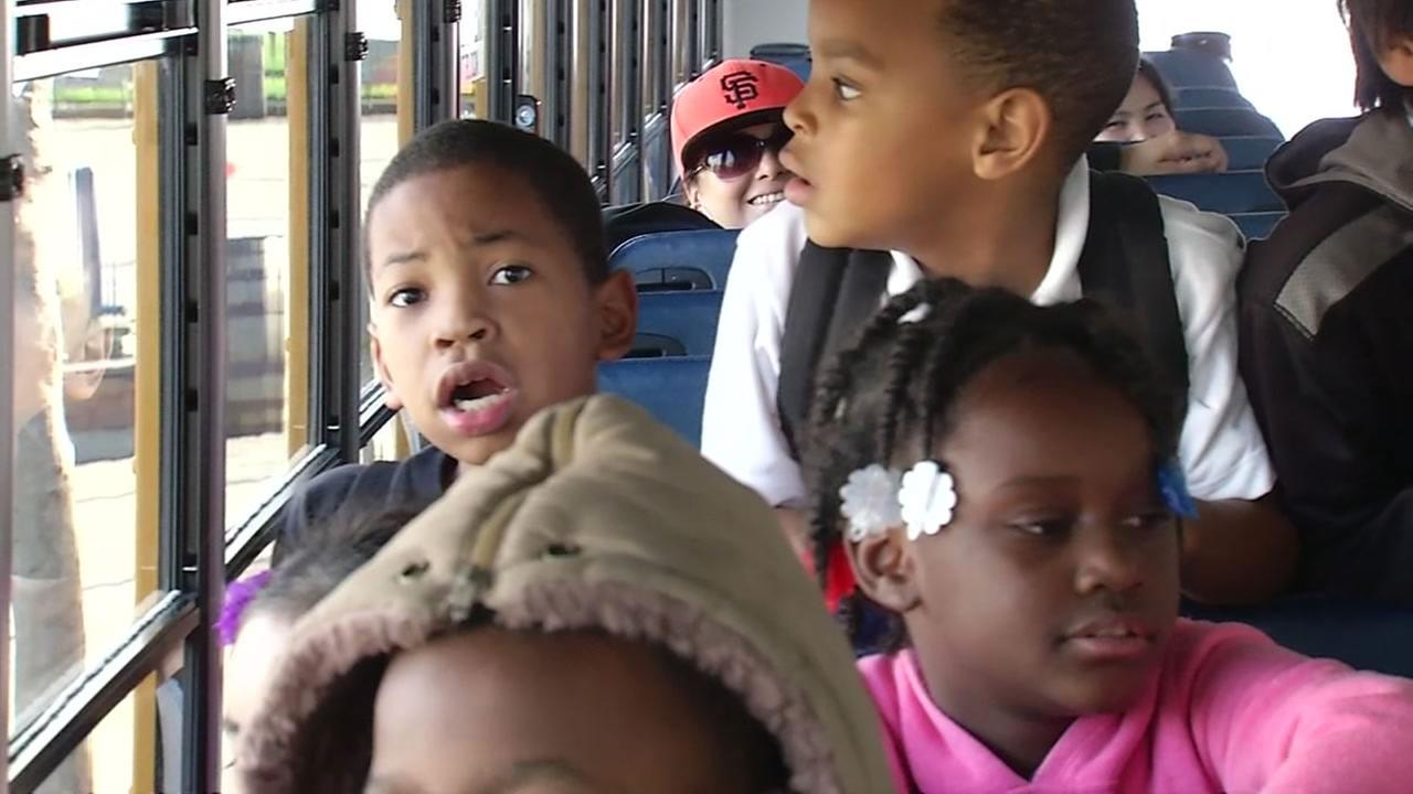 Kindergarten students are seen riding on a bus to enjoy a field trip at the Aquarium of the Bay.