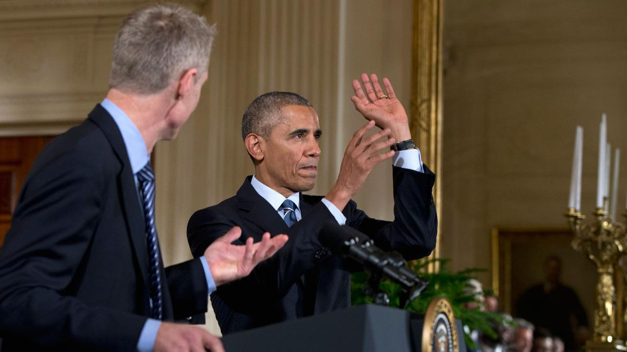 President Obama pretends to shoot a basketball as Golden State Warriors head basketball coach Steve Kerr watches during a ceremony of the White House, Thursday, February 4, 2016.AP