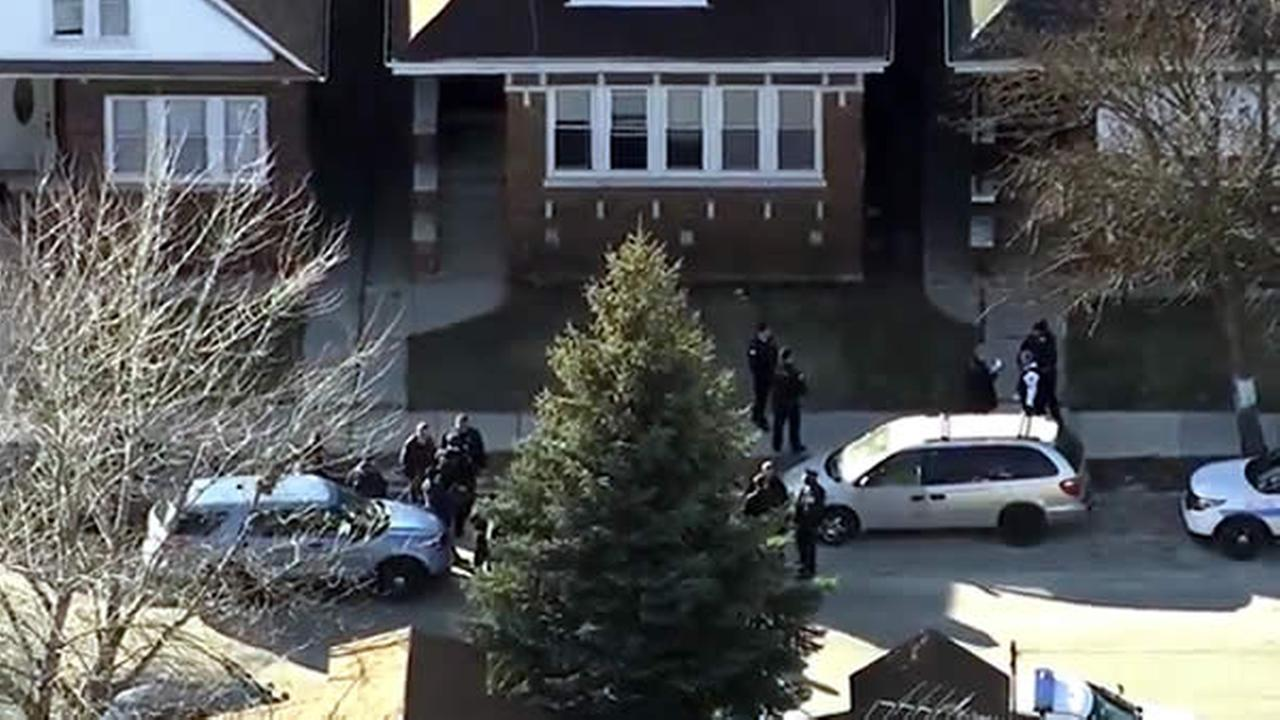 Police investigate after six people were found dead in the Gage Park neighborhood in Chicago on Thursday, February 4, 2016.