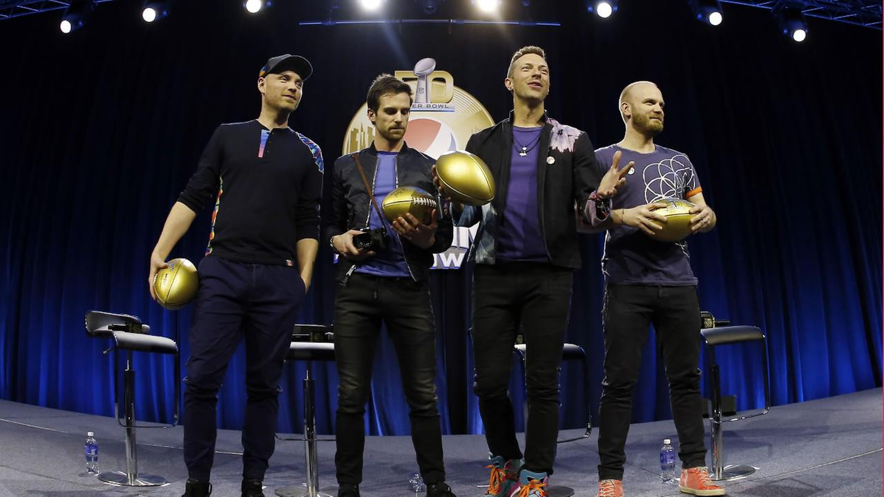 Jonny Buckland, left to right, Guy Berryman, Chris Martin and Will Champion of Coldplay are at a news conference for the upcoming NFL Super Bowl 50 football Thursday, Feb. 4, 2016.