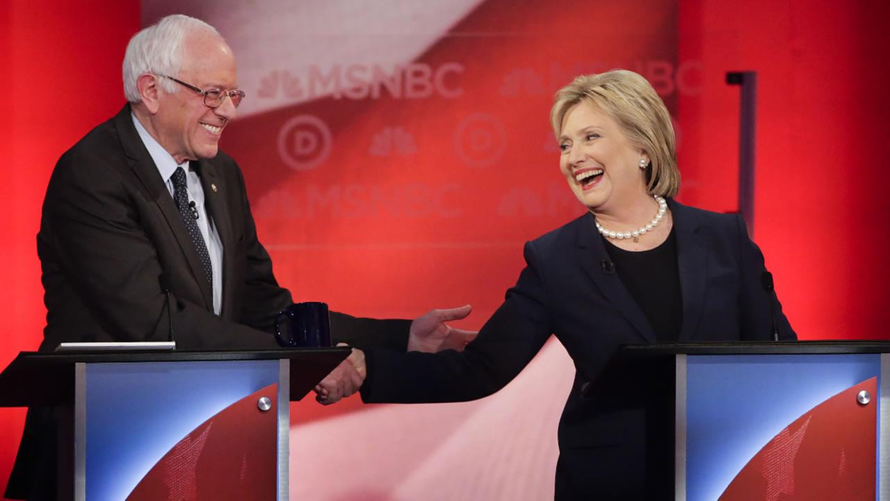 Democratic presidential candidates Sen. Bernie Sanders and Hillary Clinton shake hands during a debate hosted by MSNBC on Thurs., Feb. 4, 2016 in Durham, N.H.