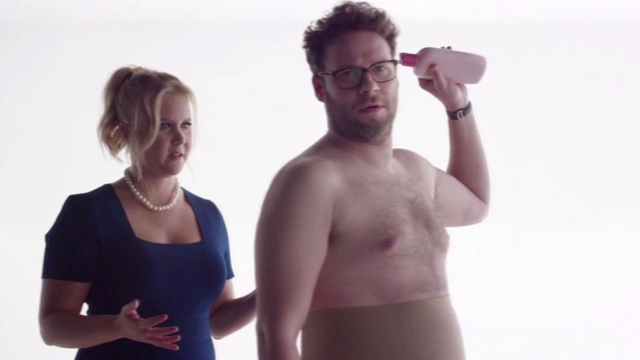 Amy Schumer and Seth Rogen in Bud Light Super Bowl commercial.