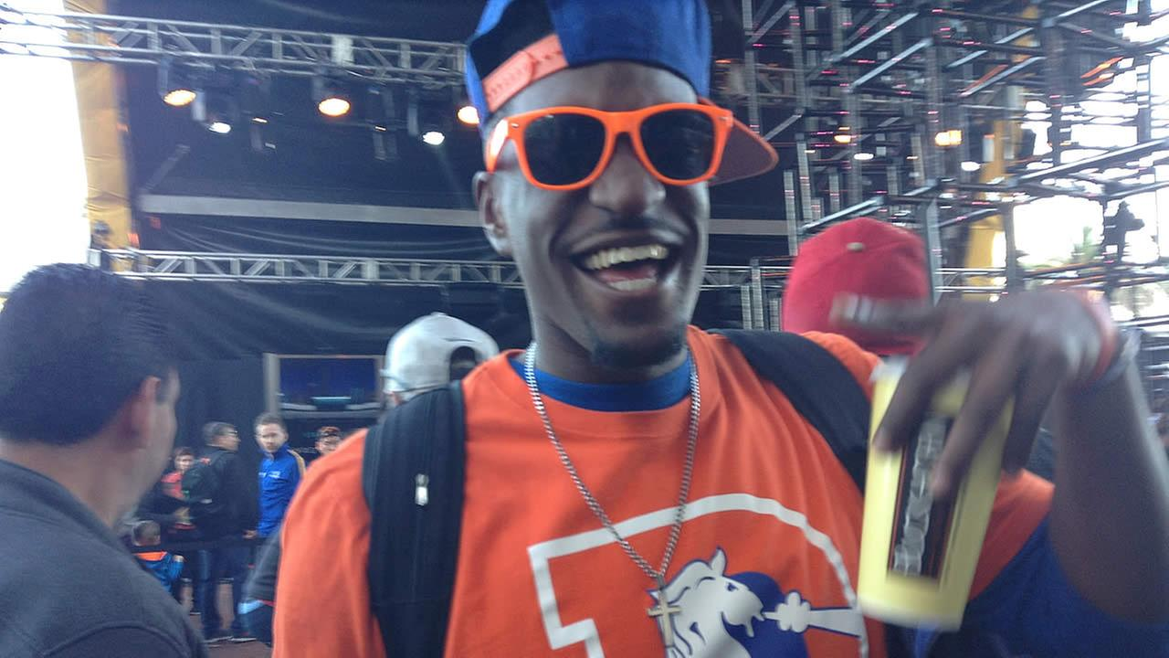 A Denver Broncos fan smiles as he makes his way through Super Bowl City in San Francisco, Calif. On February 5, 2016.KGO-TV