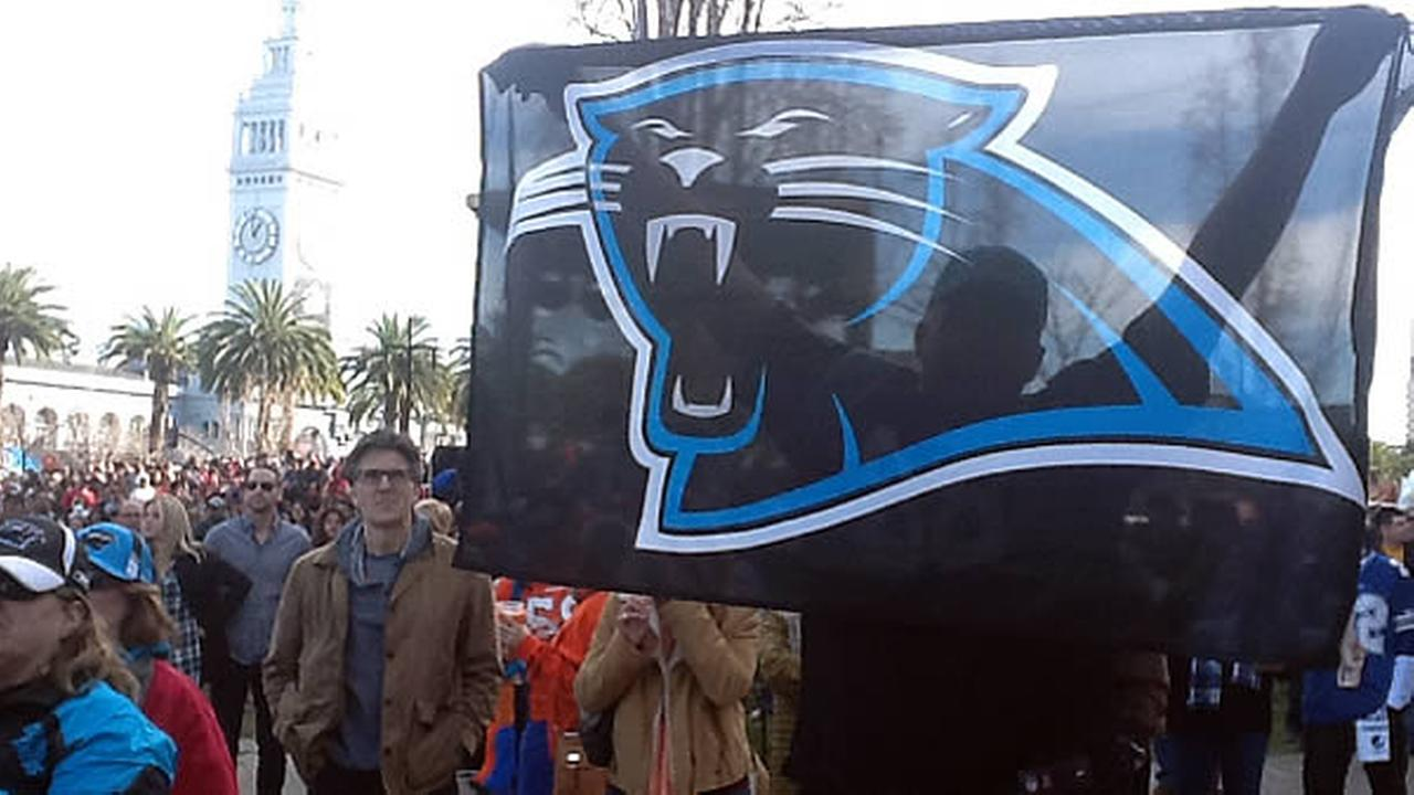 A Carolina Panthers fan holds the teams flag during a rally at Super Bowl City in San Francisco, Calif. on February 6, 2016.