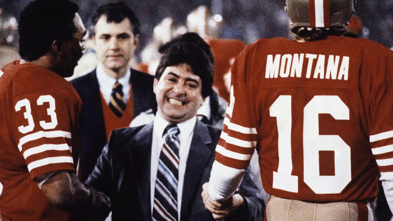 San Francisco 49ers Eddie Debartolo Jr. congratulates quarterback #16 Joe Montana