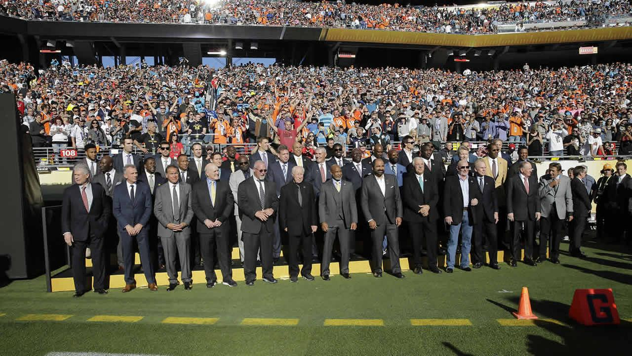 Former NFL football players pose for as photo before the NFL Super Bowl 50 football game between the Denver Broncos and the Carolina Panthers Sunday, Feb. 7, 2016, in Santa Clara, Calif. (AP Photo/David J. Phillip)AP Photo/David J. Phillip