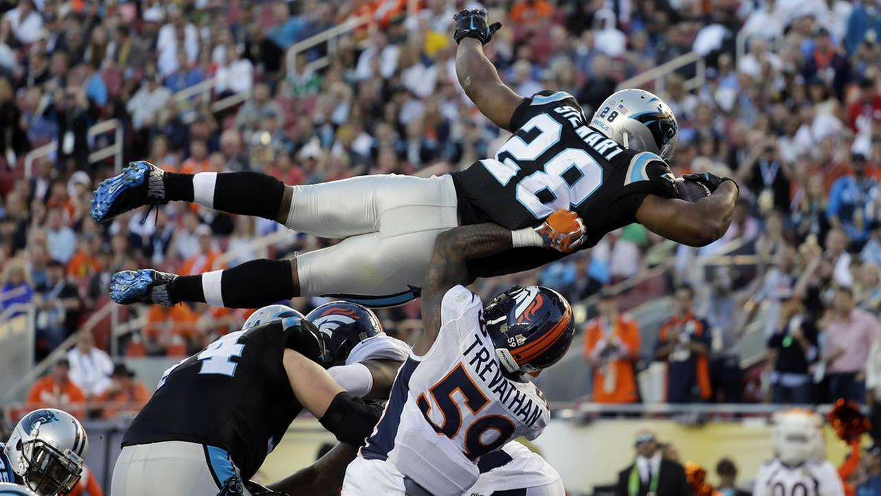 Carolina Panthers Jonathan Stewart (28) scores a touchdown during the first half of the NFL Super Bowl 50 football game against the Denver Broncos Sunday, Feb. 7, 2016, in Santa Clara, Calif. (AP Photo/Julie Jacobson)