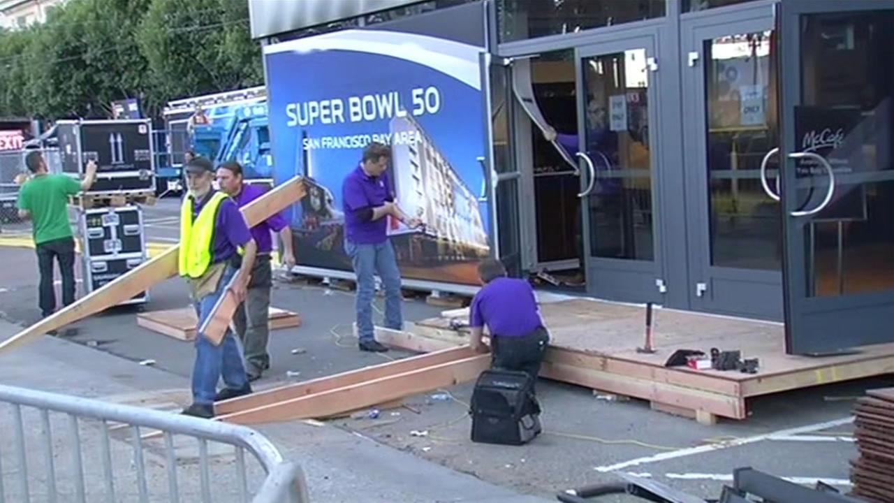 Crews tear down Super Bowl City in San Francisco on Sunday, February 7, 2016.