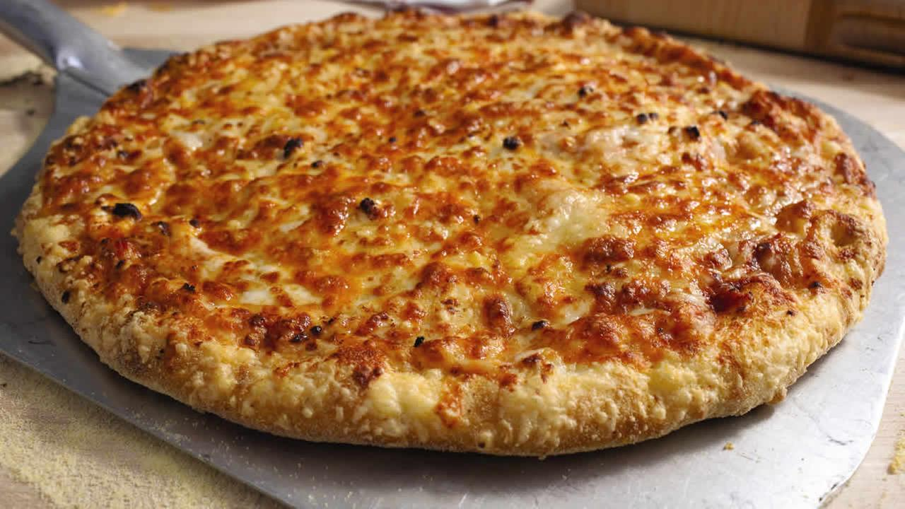 This photo provided by Dominos Pizza Inc., shows the Wisconsin 6 Cheese pizza.(AP Photo/Dominos Pizza Inc.) NO SALES