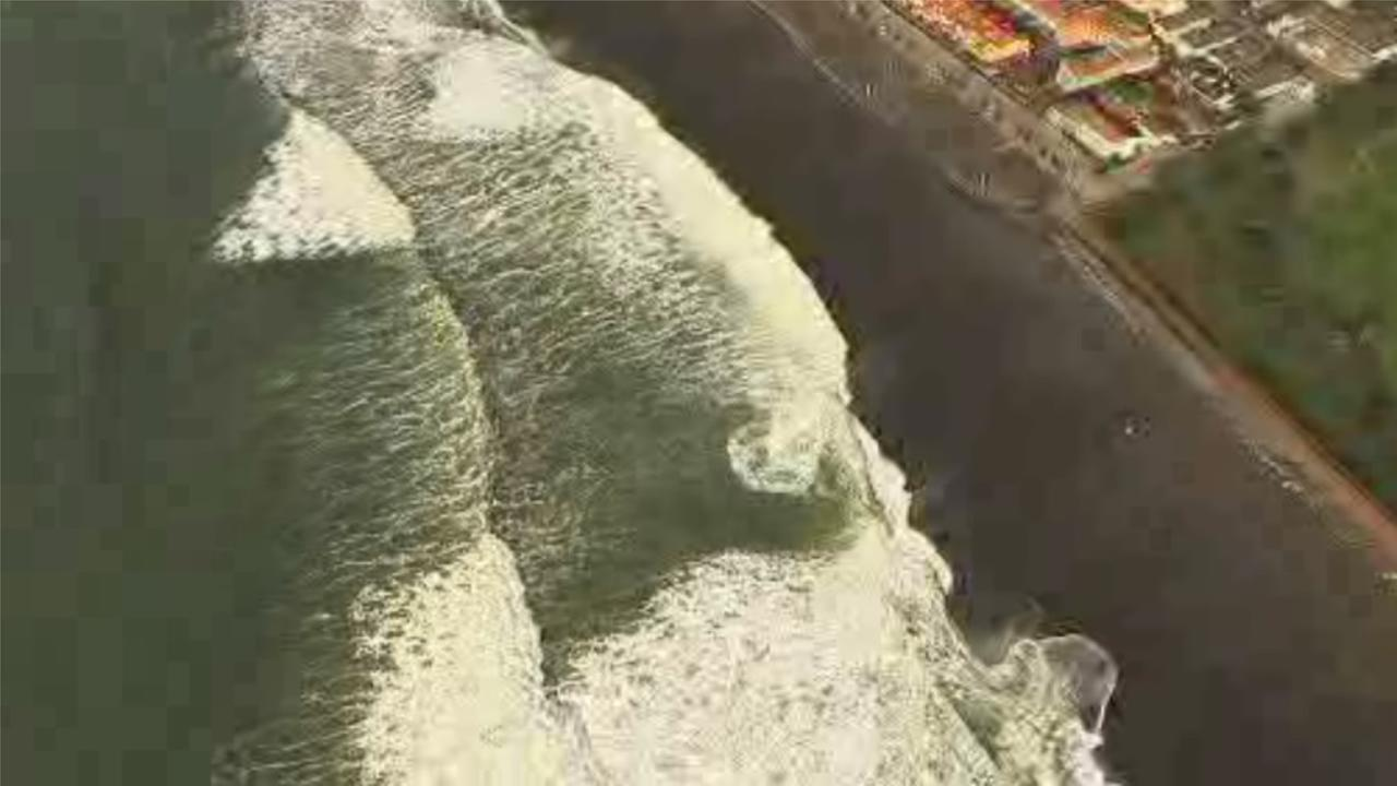 The Coast Guard pulled a man from the ocean off the coast near Pacifica, Calif., after he was swept away by a powerful ocean wave on Tuesday, February 9, 2016.