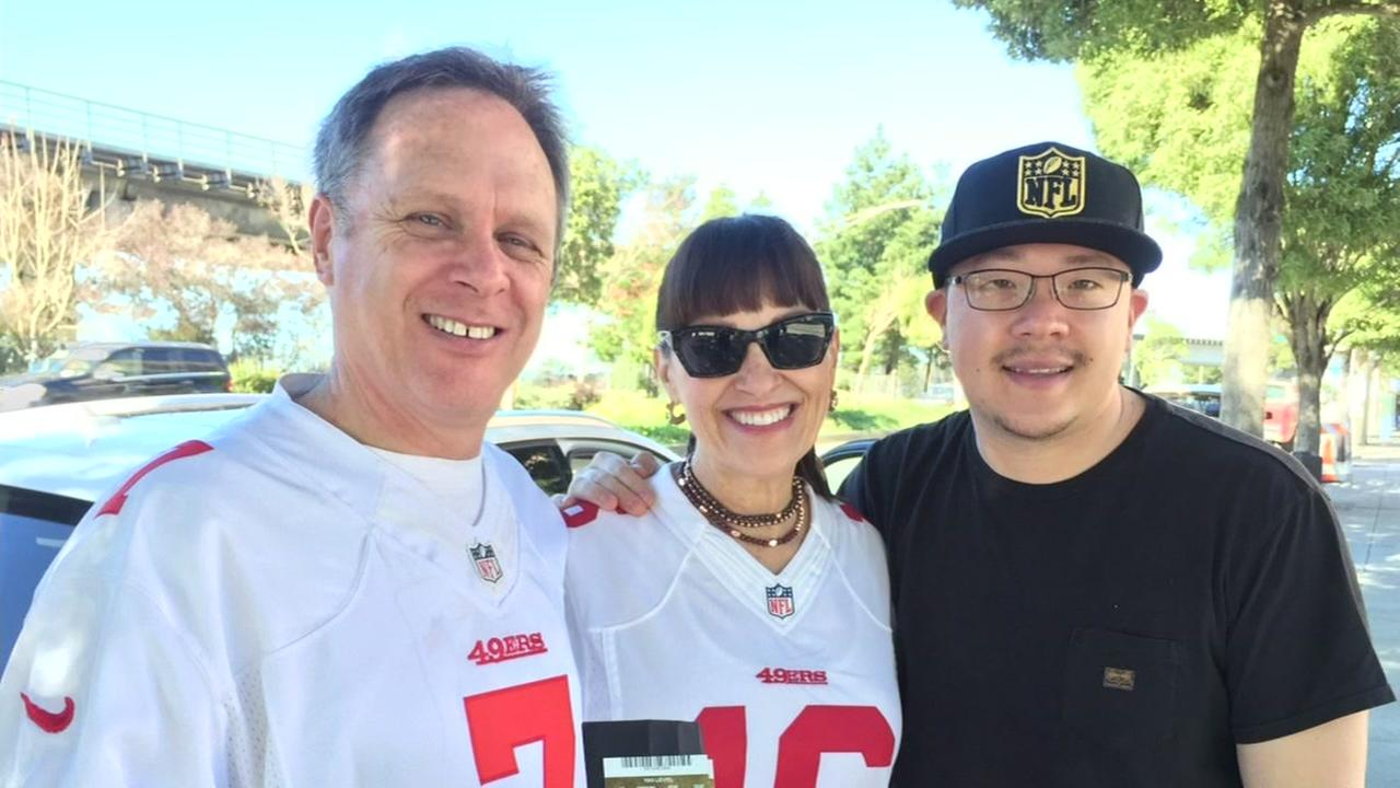 This undated photo shows Christian Huang, right, who found Super Bowl 50 tickets in San Francisco, and sold them to Guy Anthony and his wife.