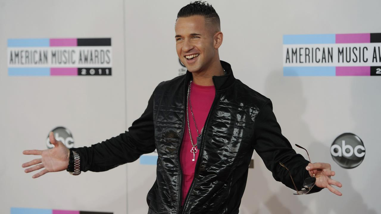 Michael Sorrentino, also known as The Situation, arrives at the 39th Annual American Music Awards on Sunday, Nov. 20, 2011 in Los Angeles. (AP Photo/Chris Pizzello)