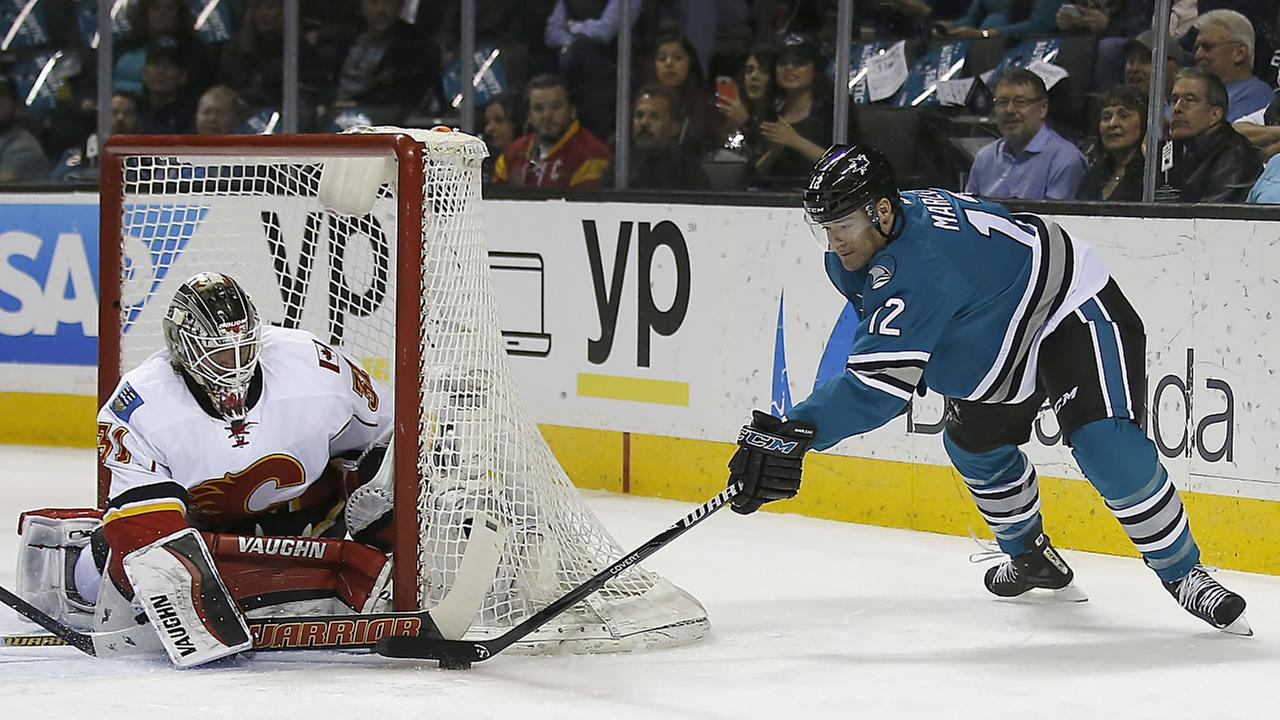 Calgary Flames goalie Karri Ramo (31) blocks a shot by San Jose Sharks center Patrick Marleau (12) during an NHL hockey game in San Jose, Calif., Thursday, Feb. Feb. 11, 2016.
