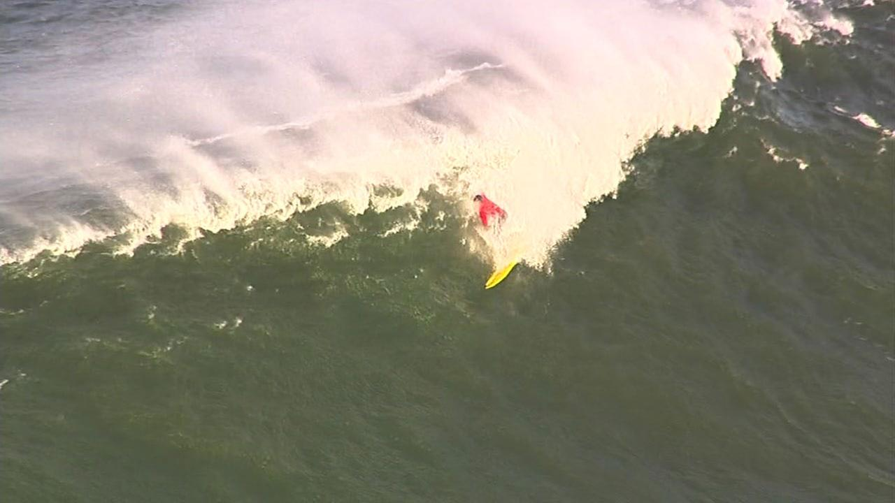 Surfer wipes out at Titans of Mavericks surf competition off coast of Half Moon Bay, California, Friday, February 2, 2016.KGO-TV