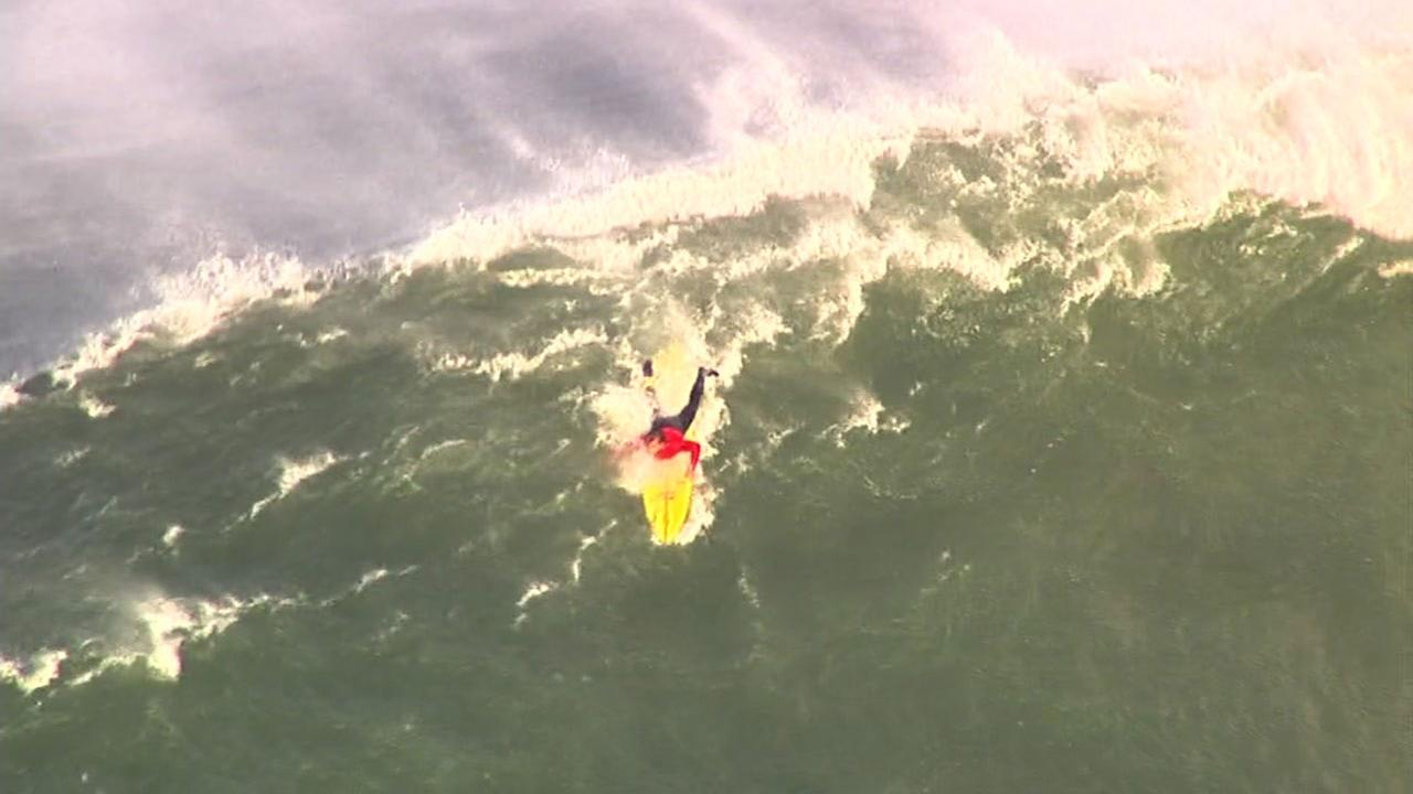Surfer attempts to ride wave at Titans of Mavericks surf competition off coast of Half Moon Bay, California, Friday, February 12, 2016.KGO-TV
