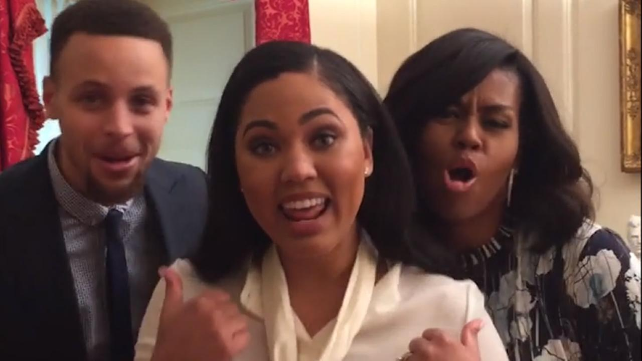 This image from video taken Thursday, February 4, 2016 in Washington D.C. shows Golden State Warriors star Steph Curry, his wife Ayesha, and First Lady Michelle Obama.