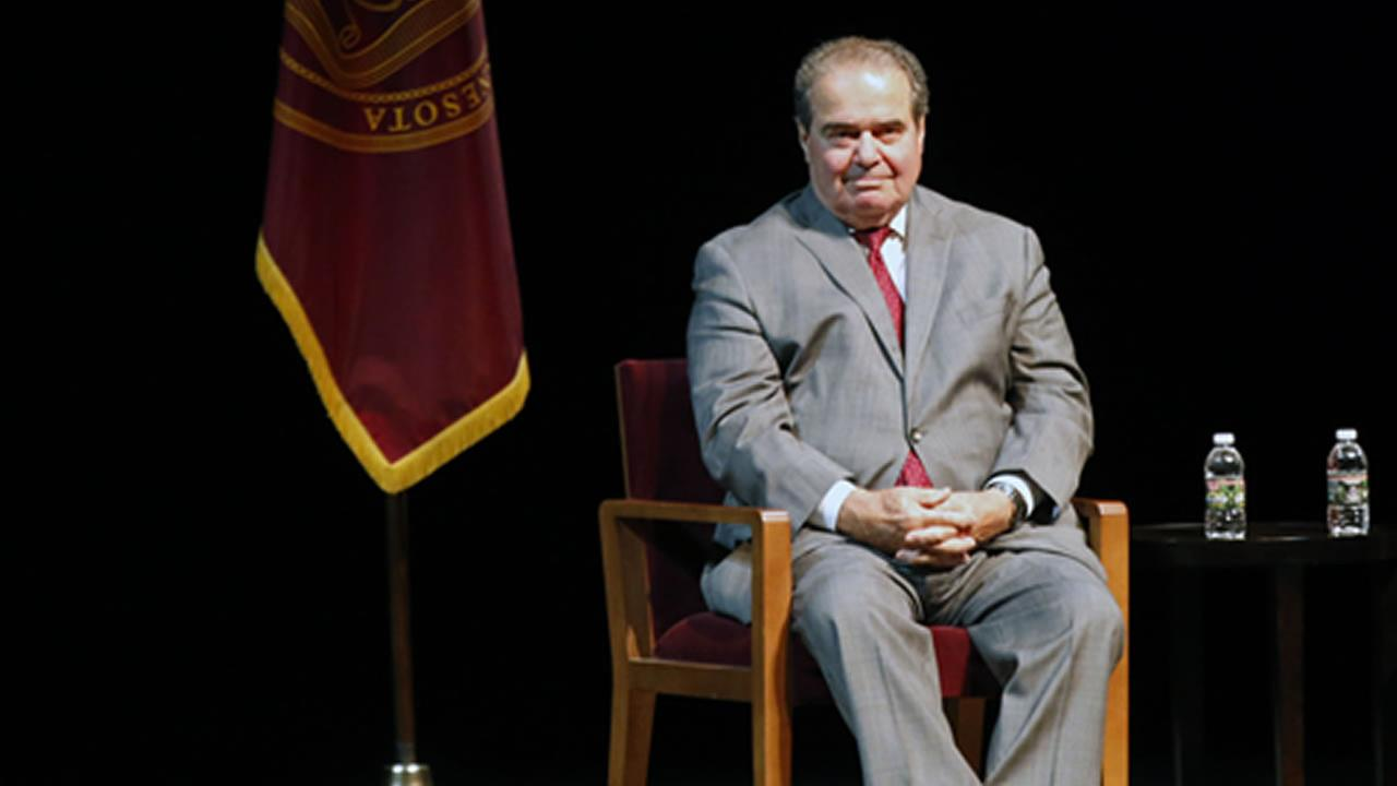 FILE - In this Oct. 20, 2015, file photo, U.S. Supreme Court Justice Antonin Scalia waits during an introduction before speaking at the University of Minnesota.