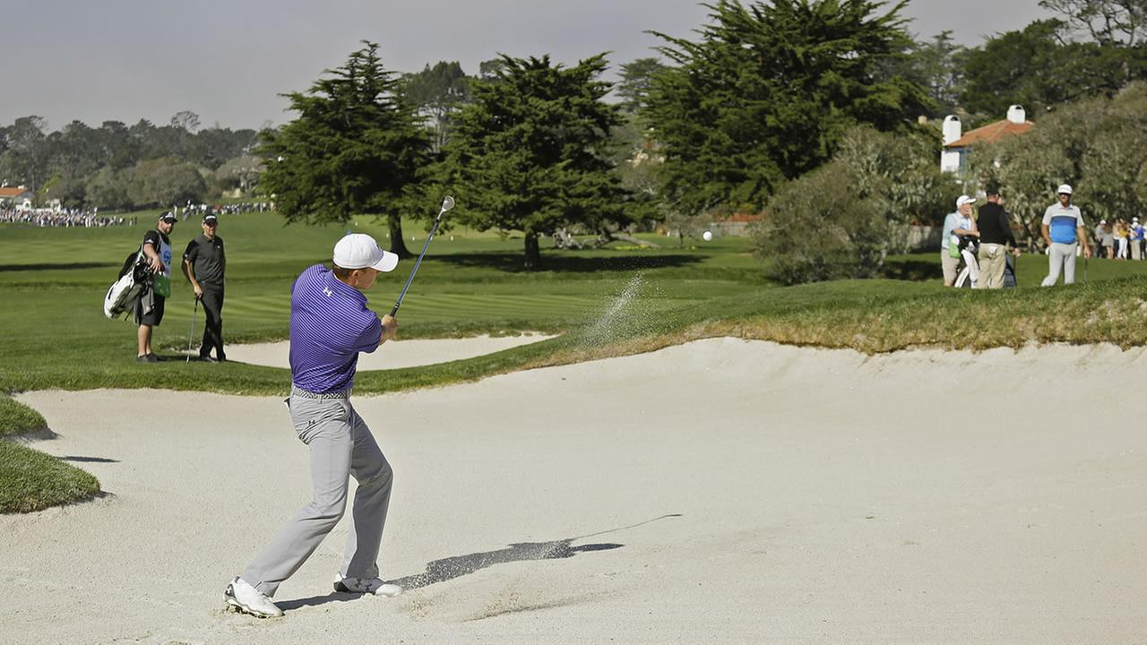 Jordan Spieth hits out of a bunker up to the second green of the Pebble Beach Golf Links during the AT&T Pebble Beach National Pro-Am golf tournament Saturday, Feb. 13, 2016.