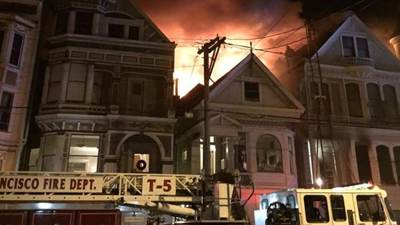 San Francisco firefighters are battling a three-alarm fire burning on Fulton Street between Baker and Lyon streets Feb. 13, 2016.