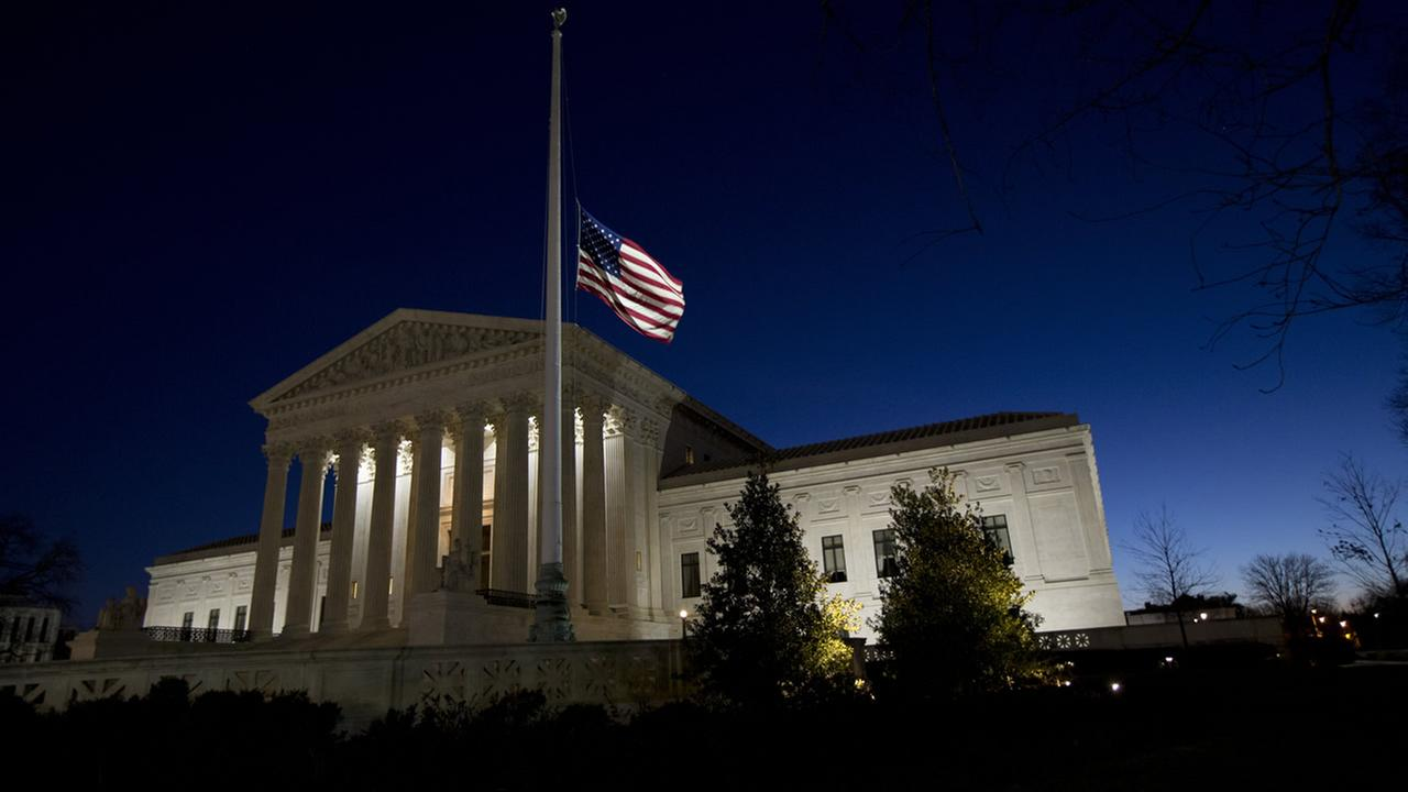 A flag flies at half-staff in front of the U.S. Supreme Court building in honor of Supreme Court Justice Antonin Scalia in Washington, Sunday, Feb. 14, 2016.