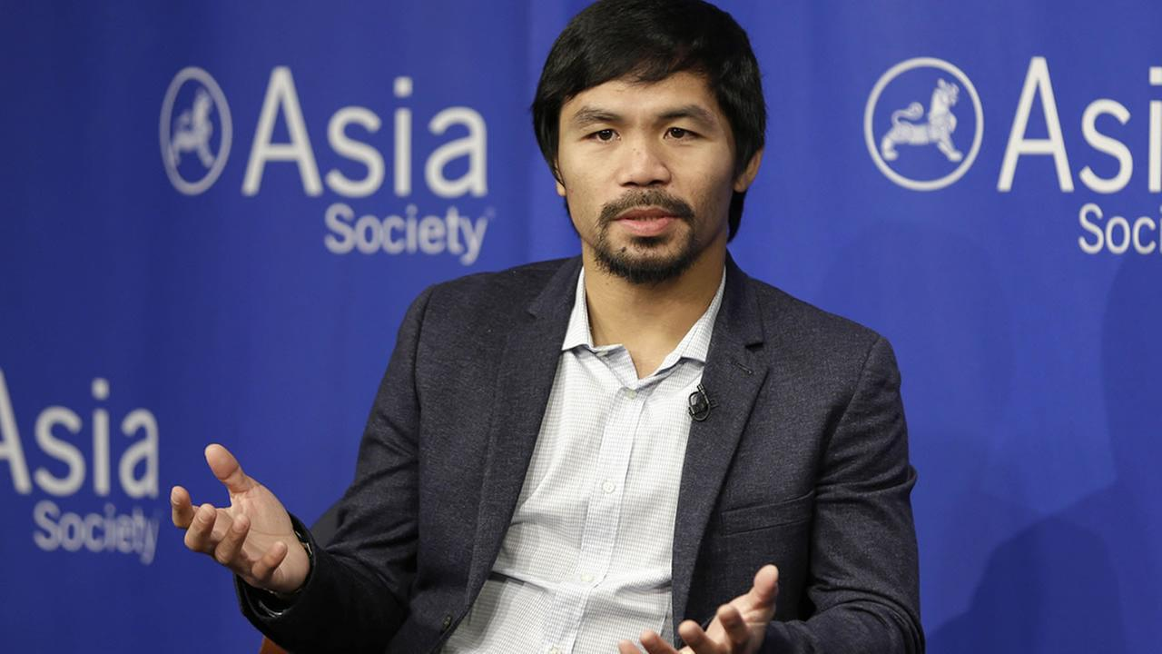 In this Oct. 12, 2015, file photo, Manny Pacquiao takes questions at the Asia Society in New York. (AP Photo/Seth Wenig, File)