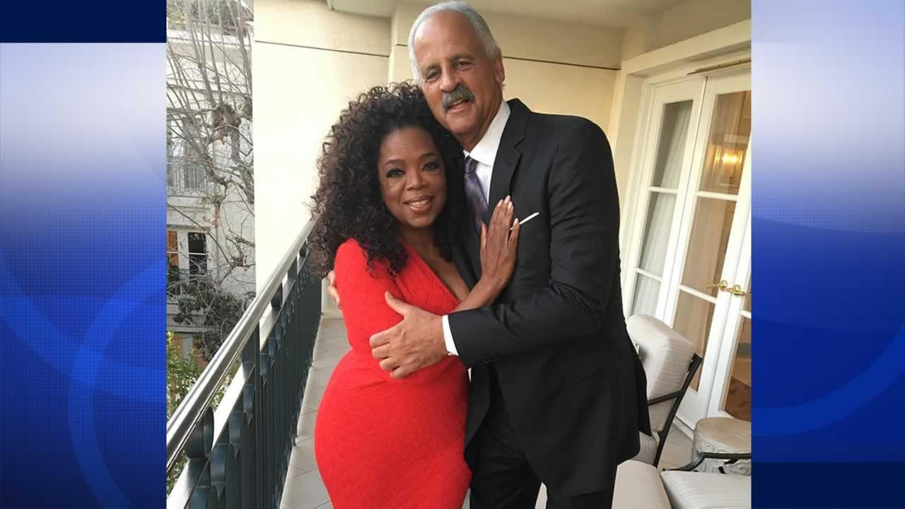 Oprah Winfrey shared this photo of herself on Monday, February 15, 2016 in a form-fitting dress on Instagram, next to longtime boyfriend, Stedman Graham.